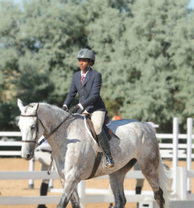 Miguel Wilson, an aspiring Olympic showjumper, riding Commander in Chief.