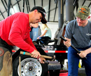 Chad Rice, CJF, left, works on a shoe with the aid of a striker. (Photo courtesy of WCB)