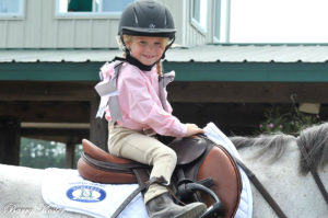 """Brooke Silver, 5, at a horse show - her mother says she's """"obsessed"""" with riding and showing."""