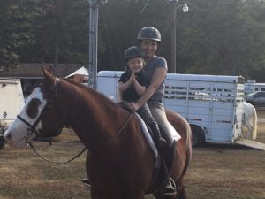 """The Collective Equestrian"" editor Liz Crumbly with her daughter on their Quarter Horse, ""Cheyenne."""